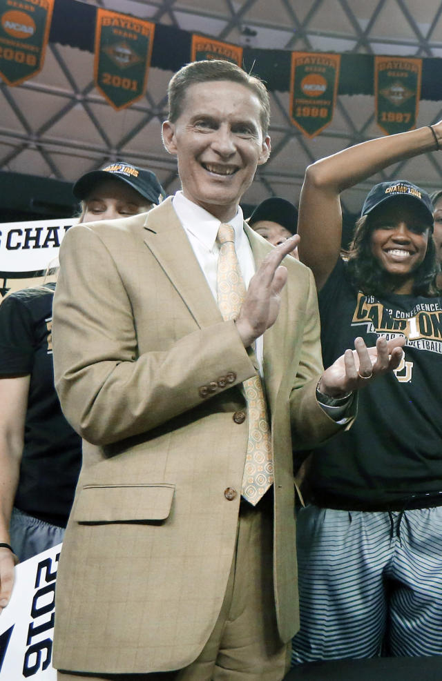 FILE - In this Feb. 29, 2016, file photo, Baylor athletic director Ian McCaw celebrates with the women's basketball team after they earned the Big 12 title following a win against Texas in an NCAA college basketball game in Waco, Texas. Ian McCaw, former athletic director at scandal-plagued Baylor, is the new athletic director at Liberty University. The school made the announcement on its web site Monday, Nov. 28, 2016. (AP Photo/Tony Gutierrez, File)