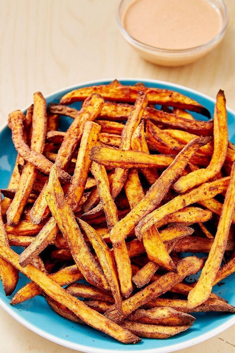 """<p>We love a good, crispy <a href=""""https://www.delish.com/uk/cooking/recipes/a28841618/perfect-baked-sweet-potato-recipe/"""" rel=""""nofollow noopener"""" target=""""_blank"""" data-ylk=""""slk:sweet potato"""" class=""""link rapid-noclick-resp"""">sweet potato</a> fry. Though the oven-baked variety is great, these air fryer fries get even crispier and take way less time! Paired with our favourite 3-ingredient secret sauce, we can't think of a better snack.</p><p>Get the <a href=""""https://www.delish.com/uk/cooking/recipes/a31012172/air-fryer-sweet-potato-recipe/"""" rel=""""nofollow noopener"""" target=""""_blank"""" data-ylk=""""slk:Air Fryer Sweet Potato Fries"""" class=""""link rapid-noclick-resp"""">Air Fryer Sweet Potato Fries</a> recipe.</p>"""