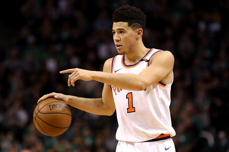 Devin Booker's scintillating run of recent form came to an unhappy end as the Phoenix Suns prodigy was carried off the court in his team's defeat to the Toronto Raptors (AFP Photo/Maddie Meyer)