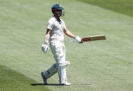 Australia's Travis Head walks from the field after he was dismissed during play on day one of the Boxing Day cricket test between India and Australia at the Melbourne Cricket Ground, Melbourne, Australia, Saturday, Dec. 26, 2020. (AP Photo/Asanka Brendon Ratnayake)