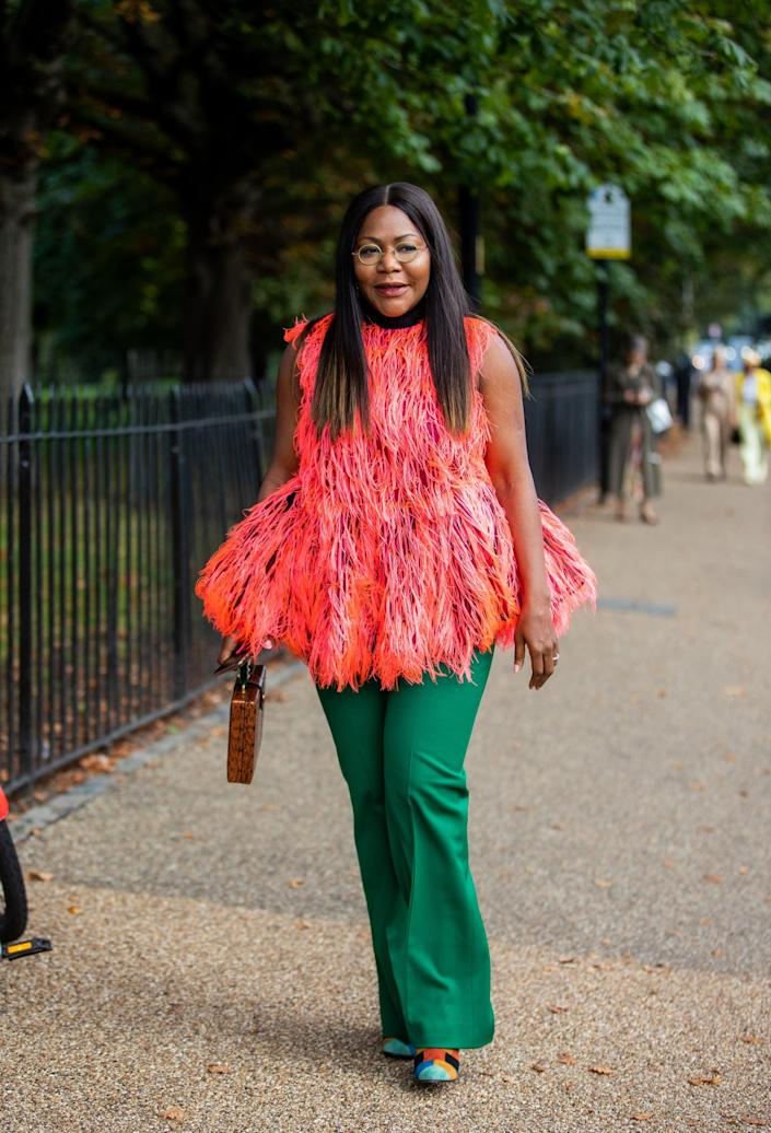 <p>A bright coral top might work with jeans, but the look gets an upgrade with emerald trousers instead. </p>