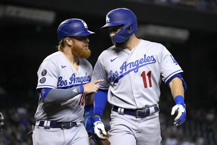 Los Angeles Dodgers' AJ Pollock celebrates with Justin Turner (10) after hitting a two-run home run.
