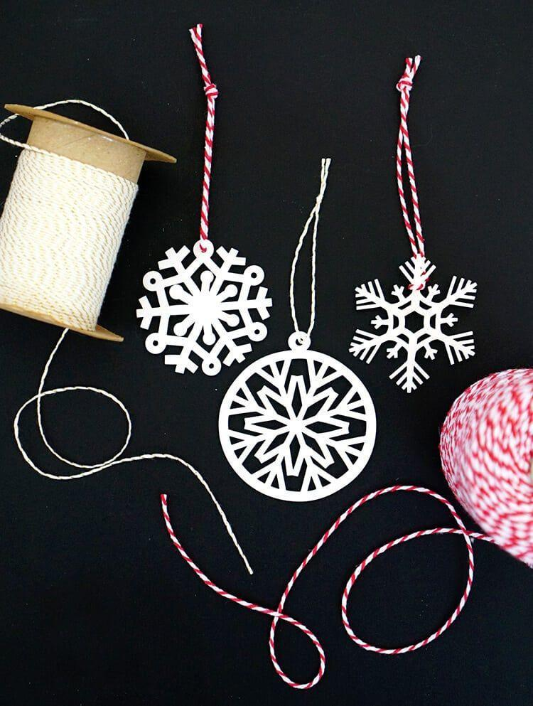 """<p>Introduce kids to a fun activity from your own childhood—shrinky dinks! Once you've watched the magic happen in the oven, a simple piece of baker's twine puts the finishing touch on these DIY ornaments. </p><p><em>Get the tutorial at <a href=""""https://www.happinessishomemade.net/shrinky-dink-snowflake-ornaments-with-cricut-explore/"""" rel=""""nofollow noopener"""" target=""""_blank"""" data-ylk=""""slk:Happiness Is Homemade"""" class=""""link rapid-noclick-resp"""">Happiness Is Homemade</a>.</em></p><p><a class=""""link rapid-noclick-resp"""" href=""""https://www.amazon.com/dp/B004QV3CCW?tag=syn-yahoo-20&ascsubtag=%5Bartid%7C10072.g.34443405%5Bsrc%7Cyahoo-us"""" rel=""""nofollow noopener"""" target=""""_blank"""" data-ylk=""""slk:SHOP SHRINK FILM"""">SHOP SHRINK FILM</a></p>"""