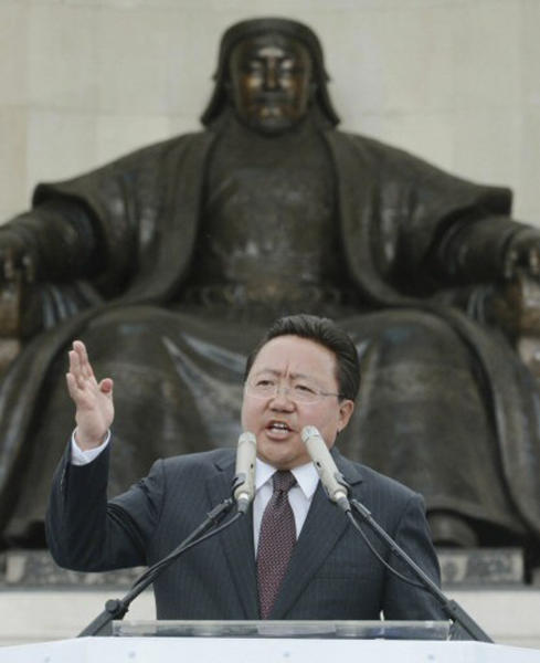 In this Sunday, June 23, 2013 photo, Mongolia's incumbent President Elbegdorj Tsakhia of the ruling Democratic Party speaks in front of a statue of Genghis Khan, the 13th century founder of the Mongol Empire, during a campaign rally in Ulan Bator, Mongolia, for Wednesday's presidential elections. One of Mongolia's colorful traditional wrestlers is the main rival to corruption-busting Elbegdorj as residents of the vast, landlocked northern Asian nation and strong U.S. ally vote in the elections. (AP Photo/Kyodo News) JAPAN OUT, MANDATORY CREDIT