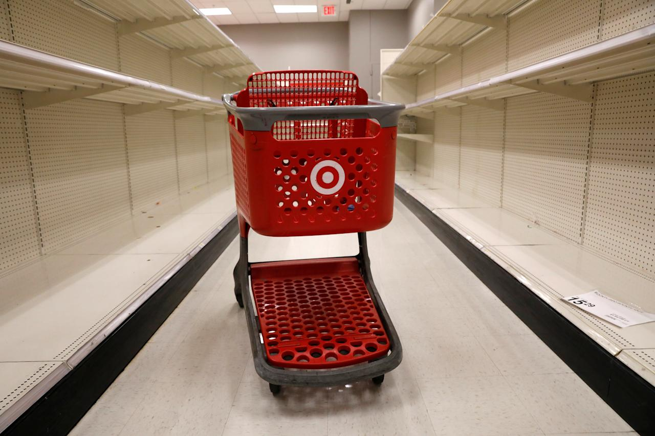 A shopping cart sits in an aisle empty of cleaning products at a Target store in Manhattan during the outbreak of the coronavirus disease (COVID-19) in New York City, New York, U.S., April 1, 2020. REUTERS/Brendan Mcdermid     TPX IMAGES OF THE DAY