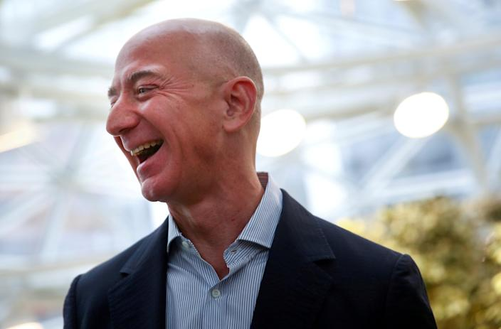 Amazon chief executive Jeff Bezos has seen his fortune swell to more than $200bn during the pandemic (REUTERS)