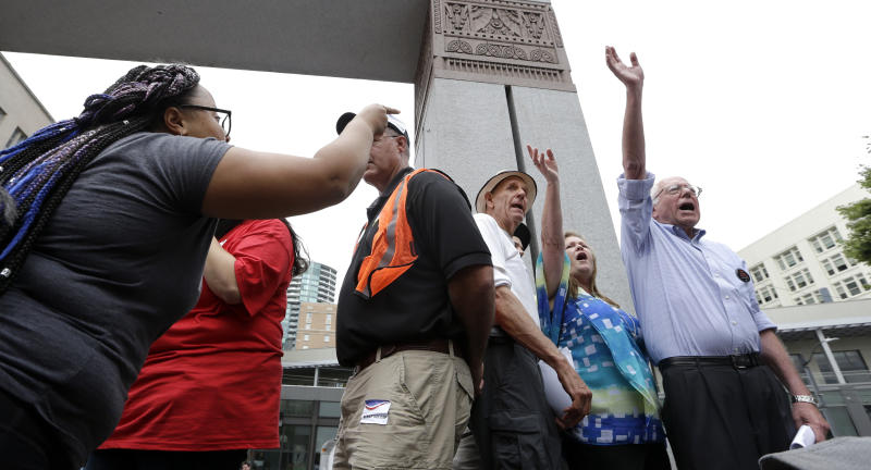 Marissa Johnson, left, of Black Lives Matter, points and yells at Sen. Bernie Sanders at a rally on Aug. 8, 2015, in downtown Seattle. (Elaine Thompson/AP)