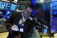 Trader James MacGilvray works on the floor of the New York Stock Exchange, Thursday, Oct. 14, 2021.Stocks are moving broadly higher in early trading on Wall Street as the market builds momentum a day after breaking a three-day losing streak. (AP Photo/Richard Drew)
