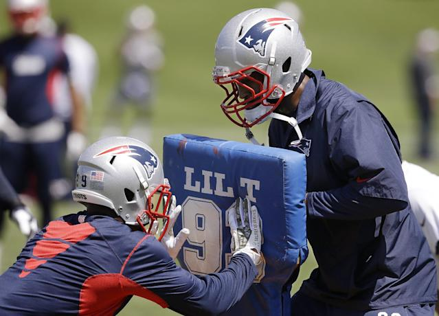 New England Patriots corner back Brandon Browner, right, and corner back Malcolm Butler, work a drill during an organized team activity at the NFL football team's facility Friday, May 30, 2014 in Foxborough, Mass. (AP Photo/Stephan Savoia)