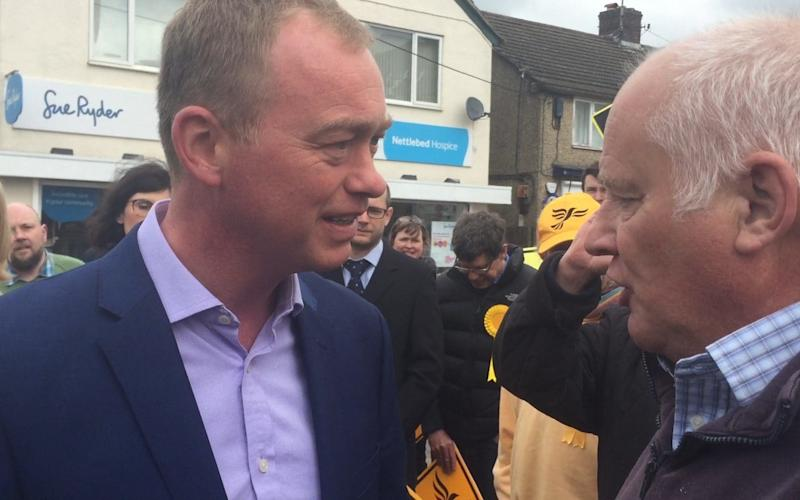 Pensioner Malcolm Baker confronts Liberal Democrat leader Tim Farron in Kidlington - Sam Lister/PA Wire