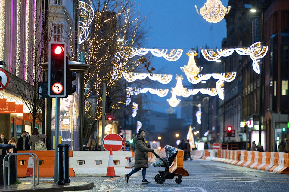 A woman with a pram on an almost empty Deansgate in Manchester city centre, as a new variant of COVID-19 keeps Christmas shoppers at home, on Monday 21st December 2020. (Credit: Pat Scaasi | MI News) (Photo by MI News/NurPhoto via Getty Images)