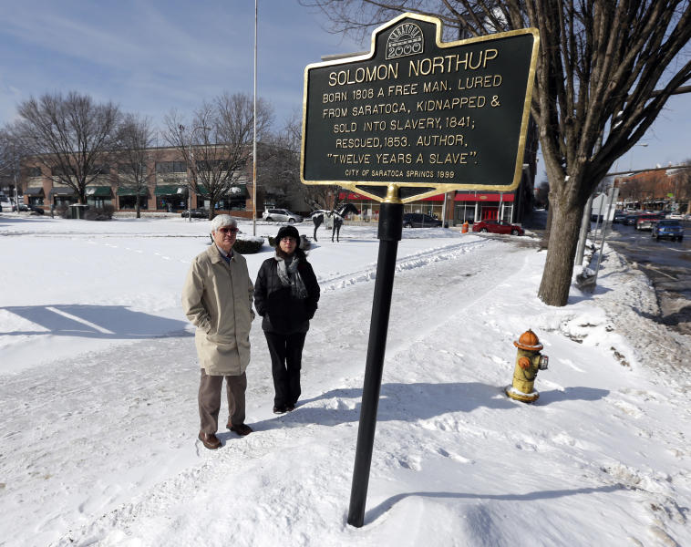 "David Fiske, left, and Rachel Seligman, two of the co-authors of ""Solomon Northup: The Complete Story of the Author of Twelve Years a Slave,"" pose at the Solomon Northup historical marker on Thursday, March 13, 2014, in Saratoga Springs, N.Y. (AP Photo/Mike Groll)"