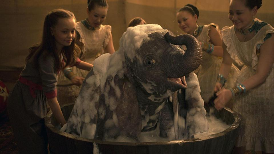 Dumbo takes a bath in this new still from Tim Burton's film. (Disney)