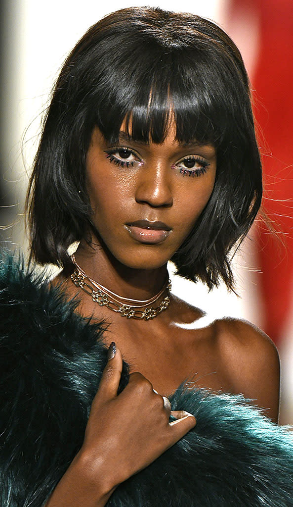 Models channeled Diana Ross with clumps of mascara and glitter at Tadashi Shoji. (Photo: Getty Images)