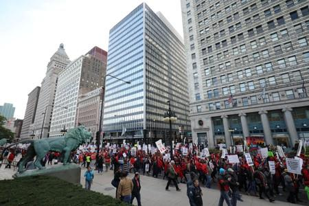 Teachers protest during a rally and march on the first day of a teacher strike in Chicago