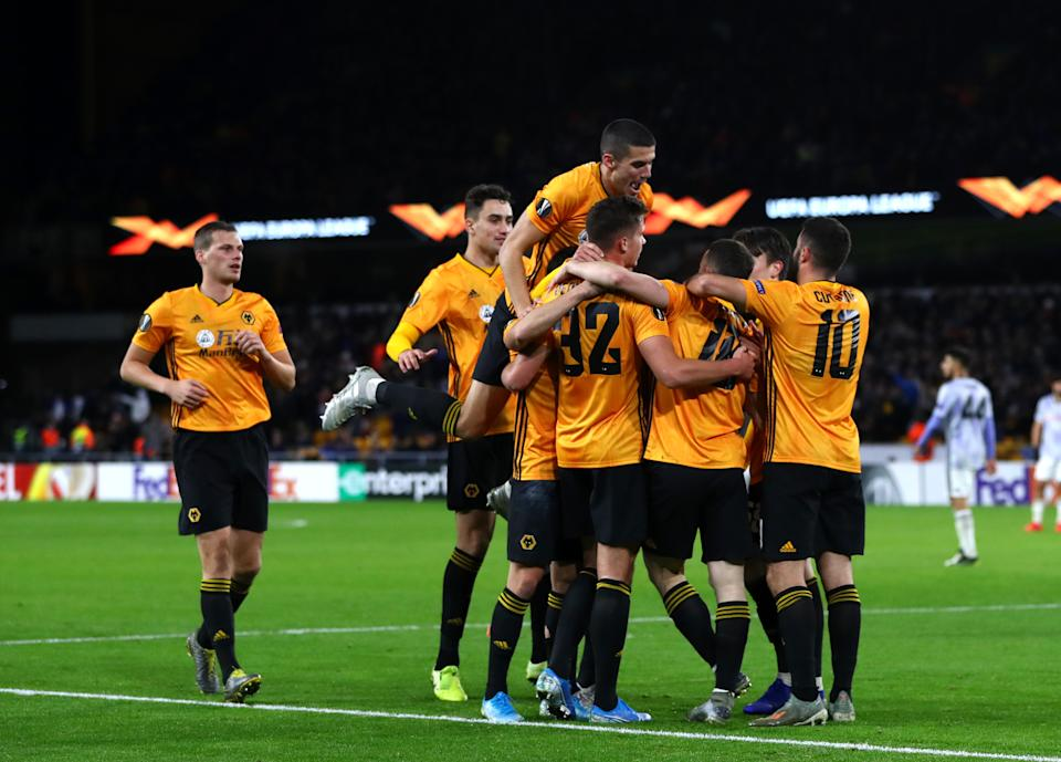 WOLVERHAMPTON, ENGLAND - DECEMBER 12:Diogo Jota of Wolverhampton Wanderers  celebrates scoring his teams second goal during the UEFA Europa League group K match between Wolverhampton Wanderers and Besiktas at Molineux on December 12, 2019 in Wolverhampton, United Kingdom. (Photo by Chloe Knott - Danehouse/Getty Images)