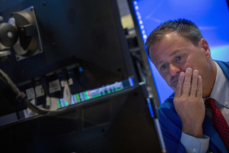 A trader watches his screen on the floor of the New York Stock Exchange