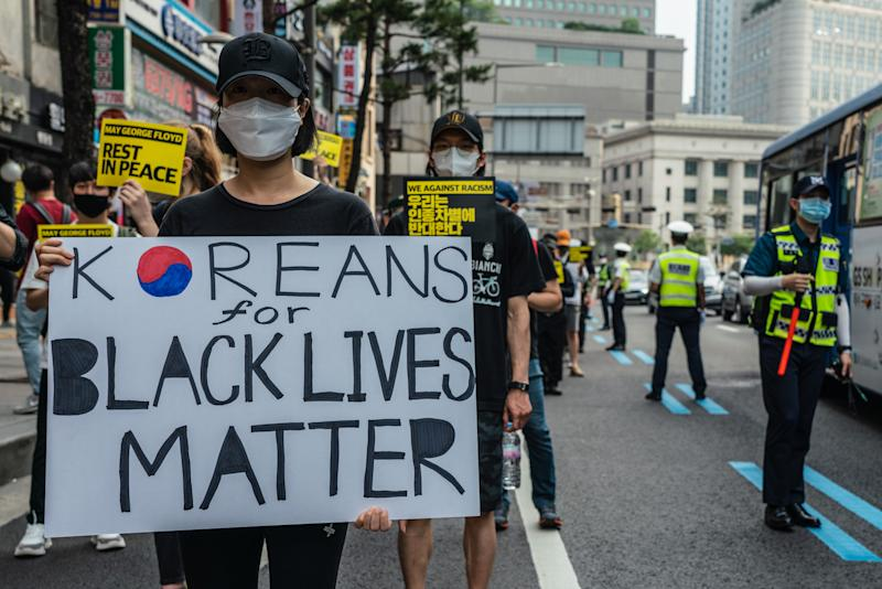 SEOUL, SOUTH KOREA - 2020/06/06: A protester wearing a protective mask holds 'Koreans For Black Lives Matter' placard during the demonstration. Thousands in Seoul support U.S. protests against police brutality that caused the May 25th murder of George Floyd in Minneapolis. (Photo by Simon Shin/SOPA Images/LightRocket via Getty Images)