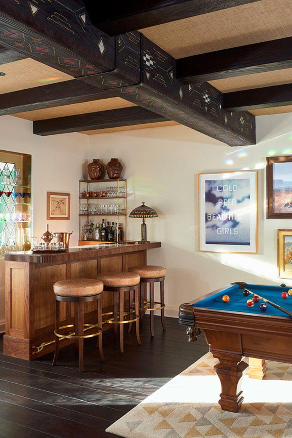 "<p>Turn an entire level—preferably a den or attic that feels like it's own private hangout—into a game zone, with each room dedicated to entertaining teens, kids, and adults alike. In this game room by <a href=""https://www.communedesign.com/"" rel=""nofollow noopener"" target=""_blank"" data-ylk=""slk:Commune Design"" class=""link rapid-noclick-resp"">Commune Design</a>, the pool table, home bar give, and kaleidoscopic stained glass reflections, it has a retro dive bar feel. </p>"