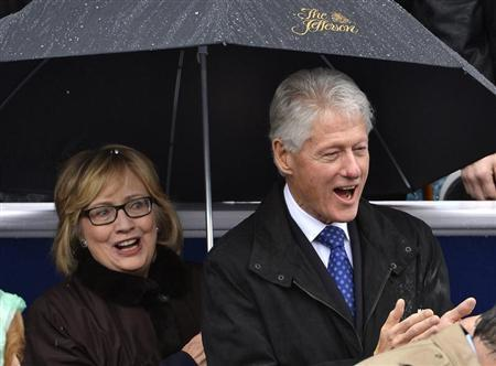 Former U.S. President Clinton and his wife Hillary attend the swearing-in ceremony of McAuliffe as Virginia's governor in Richmond