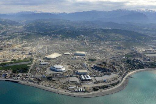 """A helicopter view taken in May 2012 of construction underway at the Olympic Park in the Black Sea resort of Sochi. Russia on Wednesday set itself the """"unbelievably"""" tough target of finishing top of the podium at its home Winter Olympic Games after placing a humiliating 11th two years ago"""