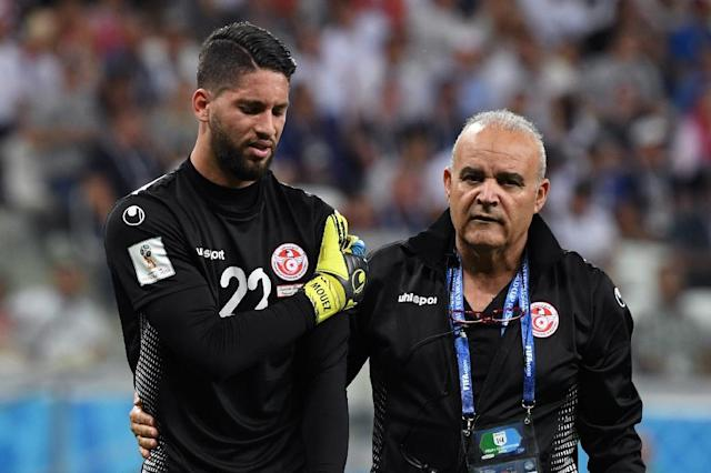 Tunisia goalkeeper Mouez Hassen comes off against England, his World Cup already over (AFP Photo/Mark RALSTON)
