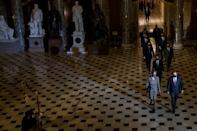 House impeachement managers walk through the Capitol's Statuary Hall to deliver the article of impeachment against Donald Trump to the Senate