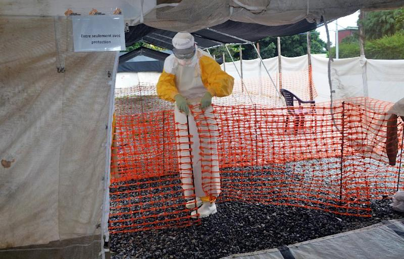 A member of Doctors Without Borders wearing protective gear walks outside the isolation ward of the Donka Hospital, on July 23, 2014 in Conakry (AFP Photo/Cellou Binani)