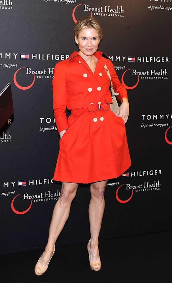 """Red is hot this season, but trench dresses are even hotter. Check out the adorable Tommy Hilfiger frock (and $665 Jimmy Choo """"Quiet"""" peep-toes) Oscar winner Renee Zellweger wore to the designer's limited edition handbag launch in Milan, Italy. Stefania D'Alessandro/<a href=""""http://www.wireimage.com"""" target=""""new"""">WireImage.com</a> - April 6, 2011"""