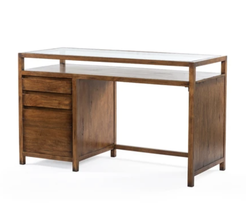 """<p>For designer quality items without """"inquire for price"""" exclusivity, check out Burke Decor. This <a href=""""https://www.burkedecor.com/collections/view-all-furniture/products/rodney-desk-reclaimed-fruitwood"""" rel=""""nofollow noopener"""" target=""""_blank"""" data-ylk=""""slk:Rodney Desk"""" class=""""link rapid-noclick-resp"""">Rodney Desk </a> is made with reclaimed fruitwood and tempered glass. </p><p><a class=""""link rapid-noclick-resp"""" href=""""https://www.burkedecor.com/collections/view-all-furniture"""" rel=""""nofollow noopener"""" target=""""_blank"""" data-ylk=""""slk:Shop"""">Shop</a> </p>"""