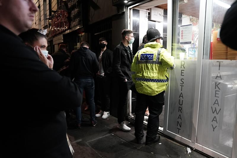 A police officer reminds workers in Newcastle city centre of the 10pm curfew that pubs and restaurants in England are subject to in order to combat the rise in coronavirus cases. Cities in northern England and other areas suffering a surge in Covid-19 cases may have pubs and restaurants temporarily closed to combat the spread of the virus.