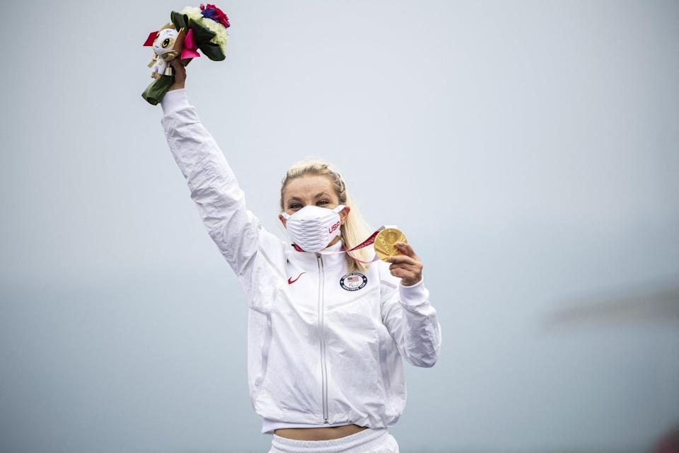 Gold medallist Oksana Masters of the US celebrates on the podium after competing in the women's cycling road individual H4-5 time trial during the Tokyo 2020 Paralympic Games at the Fuji International Speedway in Oyama on August 31, 2021. (Photo by CHARLY TRIBALLEAU/AFP via Getty Images)