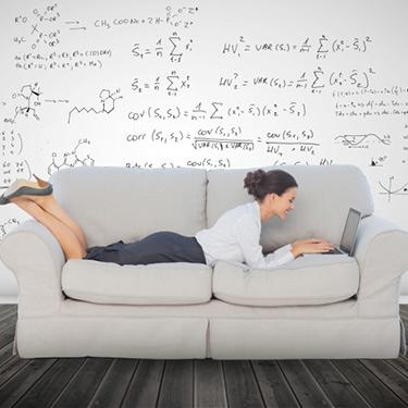 Elegant-businesswoman-lying-on-a-couch_web