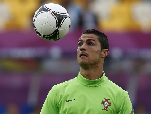 Portugal's Christiano Ronaldo watches the ball at a training session during the Euro 2012 at Arena Lviv in Lviv June 8, 2012. REUTERS/Eddie Keogh (UKRAINE - Tags: SPORT SOCCER)