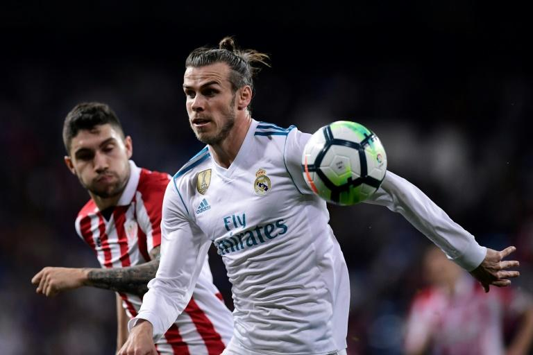 While Gareth Bale's (R) irst choice is still to stay at Real, his relationship with coach Zinedine Zidane has become strained