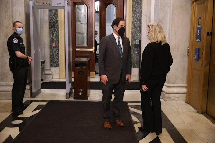Lead impeachment manager Jamie Raskin, D-Md., speaks with House Republican Conference Chairwoman Liz Cheney, R-Wyo., who is supporting his effort to remove Donald Trump. (Getty Images)
