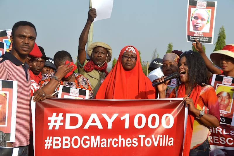 Activists of the online movement #bringbackourgirls demonstrate during a march to the Presidential Villa in Abuja