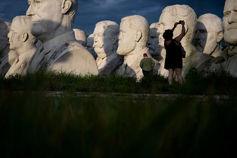 People take photos of decaying busts of former US Presidents during a night photography workshop organized by John Plashal August 25, 2019, in Williamsburg, Virginia. (Photo: Brendan Smialowski/AFP/Getty Images)