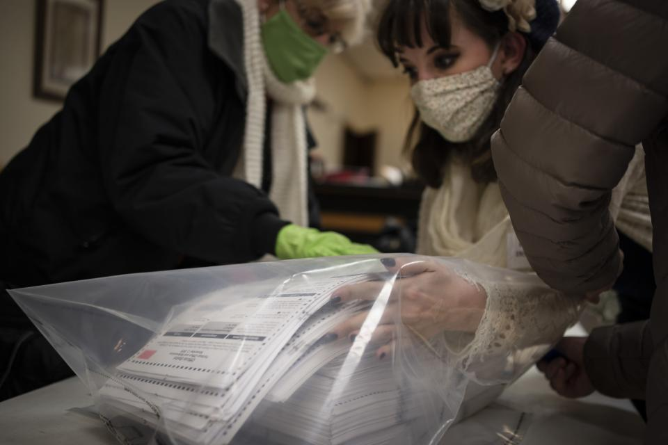 Election staff members pack ballots after polls closed at the Moose Lodge on Election Day, Tuesday, Nov. 3, 2020, in Kenosha, Wis. (AP Photo/Wong Maye-E)