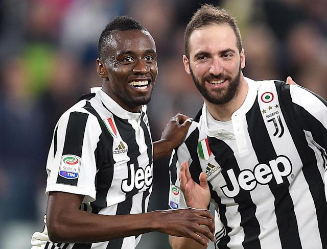 Juventus' Blaise Matuidi, left, celebrates with his teammate Gonzalo Higuain, right, after scoring his team's second goal during the Italian Serie A soccer match between Juventus and Atalanta at the Allianz Stadium in Turin, Italy, Wednesday, March 14, 2018. (Alessandro Di Marco/ANSA via AP)