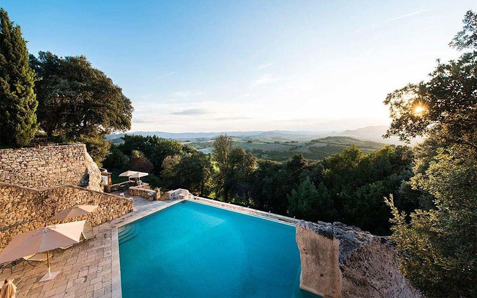 """<p>Carved from an ancient limestone quarry, this clifftop paradise surrounded by a limestone terrace is where we'd like to holiday this summer. Set in a 750-acre organic estate in Tuscany, but just an hour's drive from Florence, <a href=""""http://www.borgopignano.com/en/"""" rel=""""nofollow noopener"""" target=""""_blank"""" data-ylk=""""slk:Borgo"""" class=""""link rapid-noclick-resp"""">Borgo</a> offers some of the most best views in the region.</p>"""
