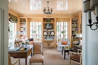 """<p>Soft orange walls and olive shades give off an intimate vibe in the library of this 1930s Spanish Colonial home in Dallas. Designer <a href=""""http://www.cathy-kincaid.com/"""" rel=""""nofollow noopener"""" target=""""_blank"""" data-ylk=""""slk:Cathy Kincaid"""" class=""""link rapid-noclick-resp"""">Cathy Kincaid</a> covered the custom club chairs in a <a href=""""http://www.claremontfurnishing.com/"""" rel=""""nofollow noopener"""" target=""""_blank"""" data-ylk=""""slk:Claremont"""" class=""""link rapid-noclick-resp"""">Claremont</a> fabric. The cocktail table is from <a href=""""https://eastandorientco.business.site/"""" rel=""""nofollow noopener"""" target=""""_blank"""" data-ylk=""""slk:East & Orient Company"""" class=""""link rapid-noclick-resp"""">East & Orient Company</a>.</p>"""