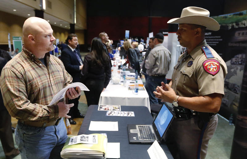 Job Seeker Brett Culver, left, of Newalla, Okla., formerly of the Air Force, talks with Texas state trooper Deon Cockrell, right, at a Recruit Military job fair in Oklahoma City, Thursday, Jan. 31, 2013. Although veterans as a whole have a lower unemployment rate than the nation at large, younger veterans who served in the years following the Sept. 11 attacks are having a much harder time finding work. (AP Photo/Sue Ogrocki)