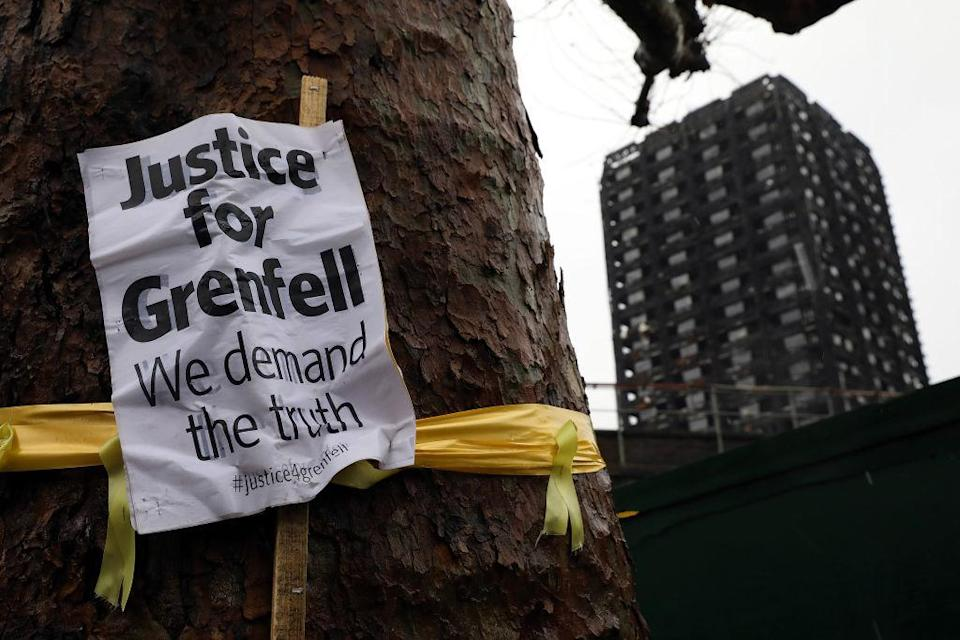 <p>A 'Justice for Grenfell' sign hangs on a tree near Grenfell Tower in London, England. An inquiry into the Grenfell Tower fire was is due to open for two days of hearings starting today. This week marks the six-month anniversary of the fire, which killed 71 people. (Dan Kitwood/Getty Images) </p>