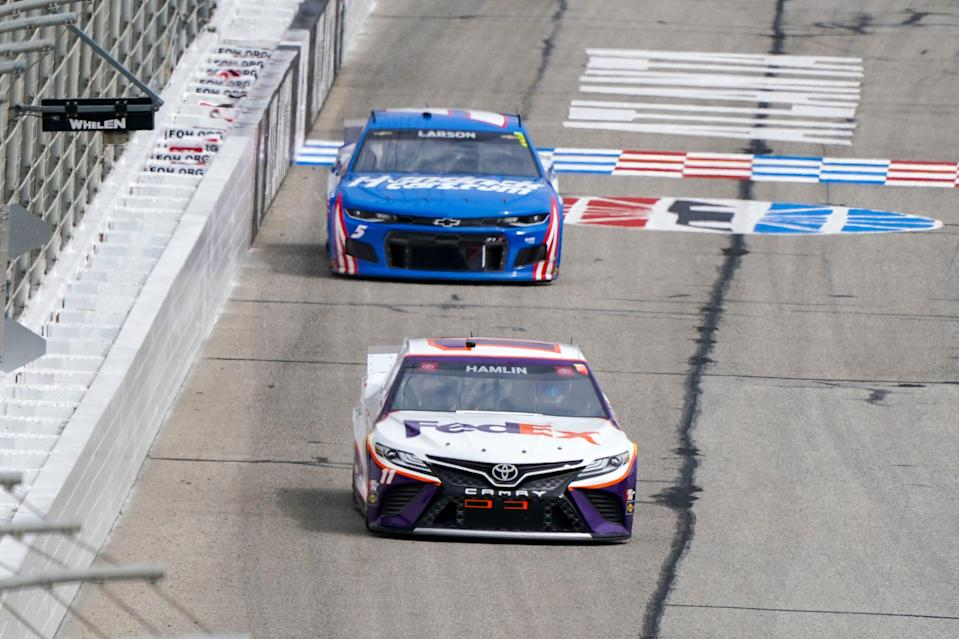 Denny Hamlin (11) leads Kyle Larson (5) during the March 21 race at Atlanta Motor Speedway. The NASCAR Cup Series heads back to Atlanta this weekend with Hamlin holding a slim lead over Larson in the standings.