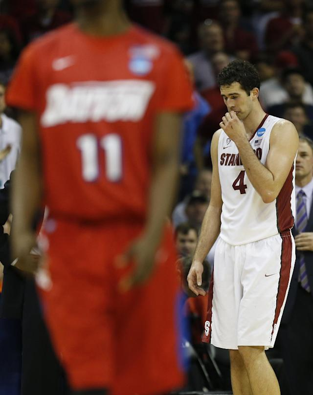 Stanford center Stefan Nastic (4) walks behind Dayton guard Scoochie Smith (11) during the second half in a regional semifinal game at the NCAA college basketball tournament, Thursday, March 27, 2014, in Memphis, Tenn. (AP Photo/John Bazemore)