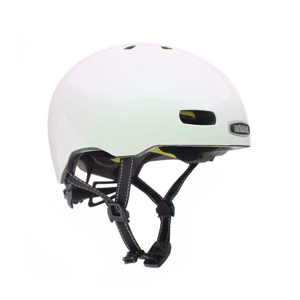 """<p><strong>Nutcase Helmets</strong></p><p>nutcasehelmets.com</p><p><strong>$79.99</strong></p><p><a href=""""https://go.redirectingat.com?id=74968X1596630&url=https%3A%2F%2Fnutcasehelmets.com%2Fcollections%2Fadult%2Fproducts%2Fcity-of-pearls-pearl-w-mips&sref=https%3A%2F%2Fwww.cosmopolitan.com%2Fstyle-beauty%2Ffashion%2Fg36231862%2Fcute-bike-helmets%2F"""" rel=""""nofollow noopener"""" target=""""_blank"""" data-ylk=""""slk:Shop Now"""" class=""""link rapid-noclick-resp"""">Shop Now</a></p><p>The pearl-like sheen of this helmet will definitely ensure that cars and pedestrians see you when you're cruising on your bike. It also has 11 air vents to help cool you down, which is an essential! </p>"""