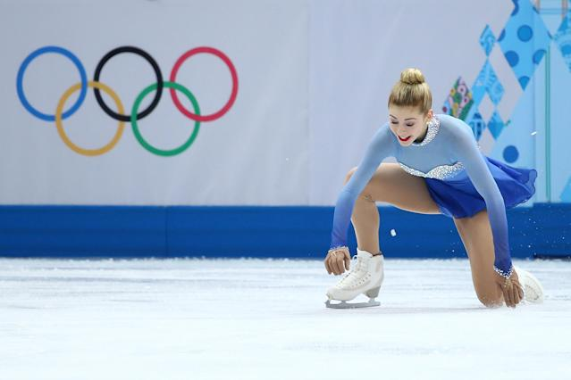 SOCHI, RUSSIA - FEBRUARY 20: Gracie Gold of the United States falls while competing in the Figure Skating Ladies' Free Skating on day 13 of the Sochi 2014 Winter Olympics at Iceberg Skating Palace on February 20, 2014 in Sochi, Russia. (Photo by Ryan Pierse/Getty Images)