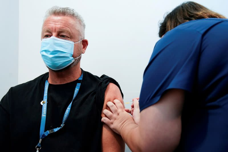 FILE PHOTO: The Pfizer COVID-19 vaccine is administered to a high-risk worker in Melbourne