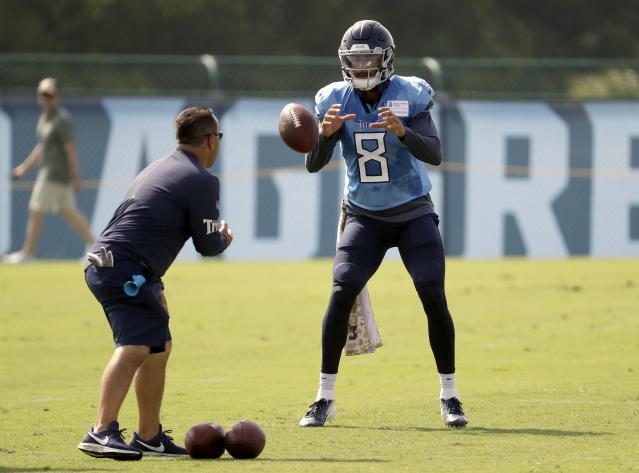 Tennessee Titans quarterback Marcus Mariota (8) takes a snap during a combined NFL football training camp with the Tampa Bay Buccaneers Wednesday, Aug. 15, 2018, in Nashville, Tenn. (AP Photo/Mark Humphrey)